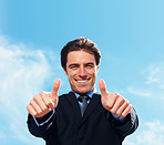 Smart business man with thumbs up with copyspace against sky