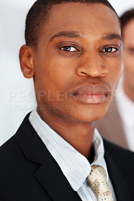 Buy stock photo Closeup portrait of a handsome young businessman looking confident