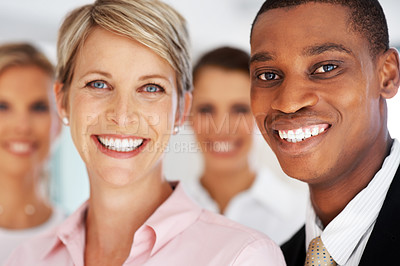 Buy stock photo An attractive diverse business man and woman standing in front of team at office