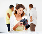 Woman checking out images in camera