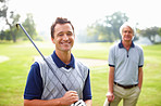 Male golfer smiling