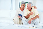 Mature couple calculating home budget