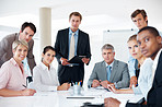 Successful business people sitting together in meeting