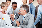 Businesspeople seriously discussing on certain business concerns