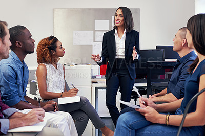 Buy stock photo Shot of a group of office workers in a meeting