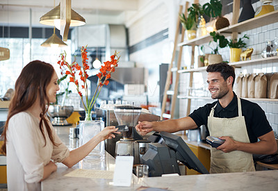 Buy stock photo Cropped shot of a male barista helping a customer in a coffee shop