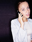 Confused business woman speaking over cellphone