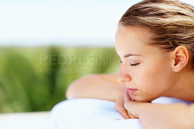 Buy stock photo Profile view of a relaxed young woman with eyes closed at a health spa