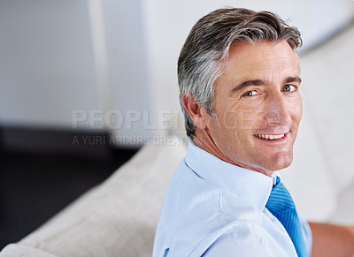 Buy stock photo Portrait of a mature businessman sitting on a sofa