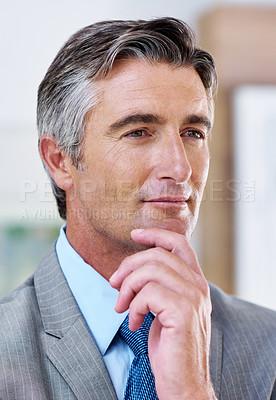 Buy stock photo Shot of a mature businessman deep in thought