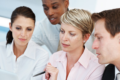 Buy stock photo Diverse group of business colleagues at the office working on a laptop