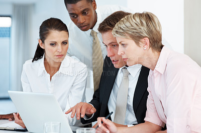 Buy stock photo Group of successful young businesspeople together working on laptop and discussing at office