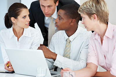 Buy stock photo Group of successful young businesspeople discussing new project at a meeting