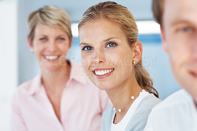 Buy stock photo Portrait of a happy young business woman smiling with her colleagues