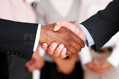 Buy stock photo Closeup of business people shaking hands with eachother - Act of agreement