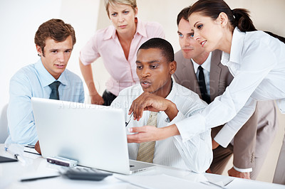 Buy stock photo Portrait of a diverse group of business people working together on laptop