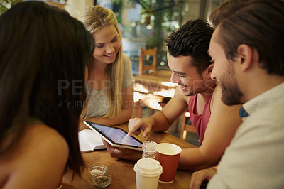 Buy stock photo Shot of a group of friends hanging out at a coffee shop