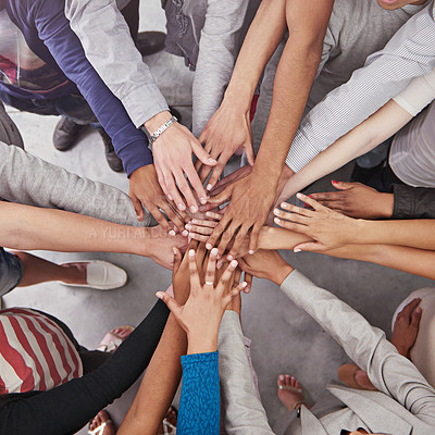 Buy stock photo Cropped shot of a business team standing in a circle with their hands stacked