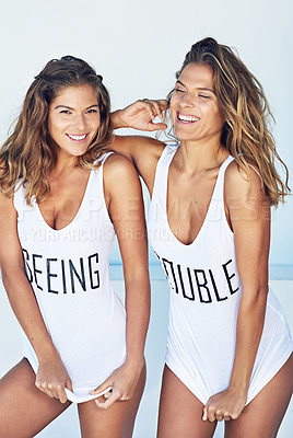 Buy stock photo Cropped shot of twins standing against a white wall