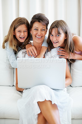 Buy stock photo Portrait of mother and her two daughters using laptop and smiling