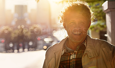 Buy stock photo Portrait of a happy mature man in the city