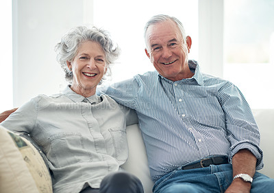 Buy stock photo Portrait of a senior couple sitting on the sofa at home