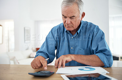 Buy stock photo Cropped shot of a senior man using a calculator while reviewing his budget