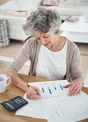 Buy stock photo Cropped shot of a senior woman working on her finances at home
