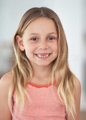 Buy stock photo Cropped portrait of a cute little girl standing indoors