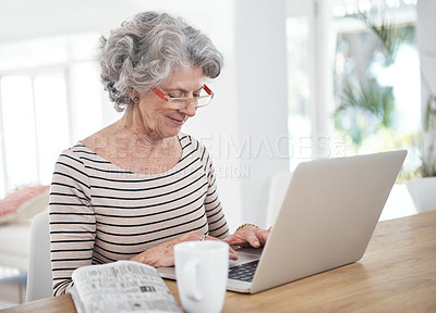 Buy stock photo Cropped shot of a senior woman using her laptop at home