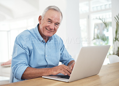 Buy stock photo Shot of a senior man using a laptop at home