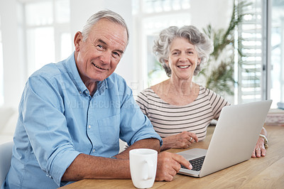 Buy stock photo Shot of a senior couple using a laptop at home