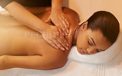 Buy stock photo Cropped shot of a young woman getting a massage at the spa