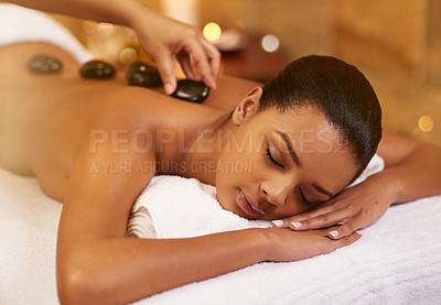 Buy stock photo Cropped shot of a young woman enjoying some lastone therapy at the spa