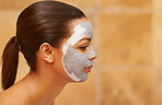 Treating her skin to a pampering mask
