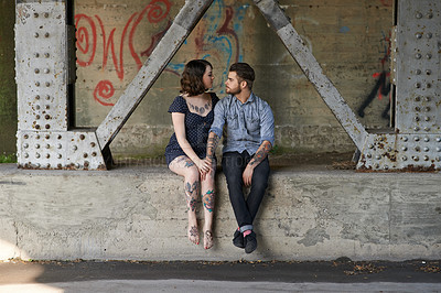 Buy stock photo Shot of an affectionate young couple in urban surroundings