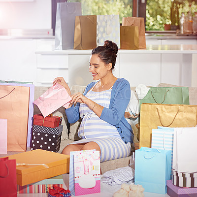 Buy stock photo Shot of a young pregnant woman at her baby shower