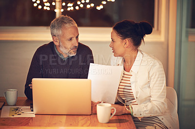 Buy stock photo Cropped shot of two colleagues working late at the office