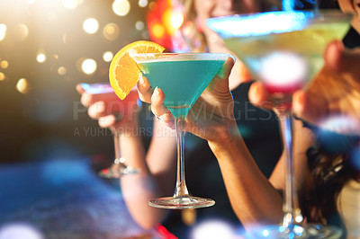 Buy stock photo Cropped shot of women drinking cocktails in a nightclub