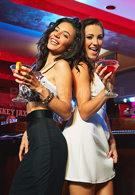 Buy stock photo Shot of young women partying in a nightclub