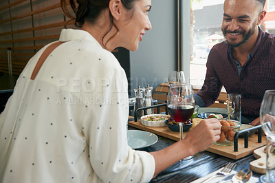 Buy stock photo Cropped shot of a young couple on a dinner date