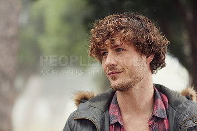 Buy stock photo Cropped shot of a young man outdoors