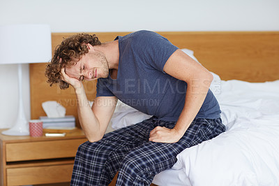 Buy stock photo A young man suffering from a headache
