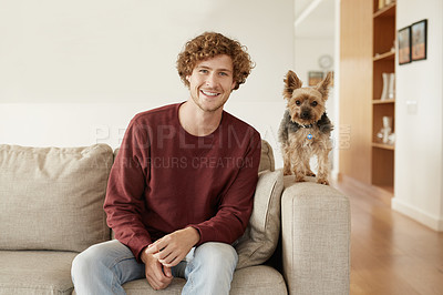 Buy stock photo Portrait of a young man and his terrier sitting in the living room