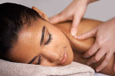 Buy stock photo Cropped shot of a young woman enjoying a massage at a spa
