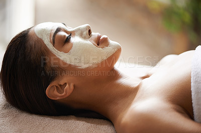 Buy stock photo Cropped shot of a beautiful young woman relaxing during a facial treatment at a spa
