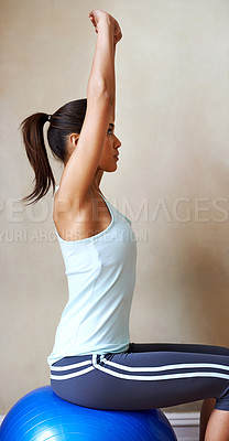 Buy stock photo Shot of a young woman doing pilates at home