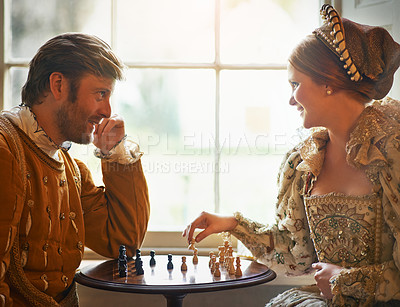 Buy stock photo Shot of a an aristocratic couple playing chess