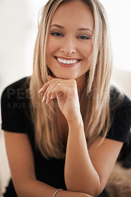 Buy stock photo Portrait of a young woman sitting with her hand on her chin