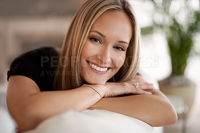 Buy stock photo Portrait of a young blonde woman relaxing on the sofa at home